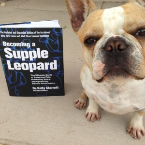 Bee shows off her favorite strength training and mobility book: Becoming a Supple Leopard by Kelly Starrett and Glen Cordoza