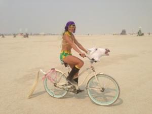 Charging the playa on my girlfriend Melissa's unicorn bike.